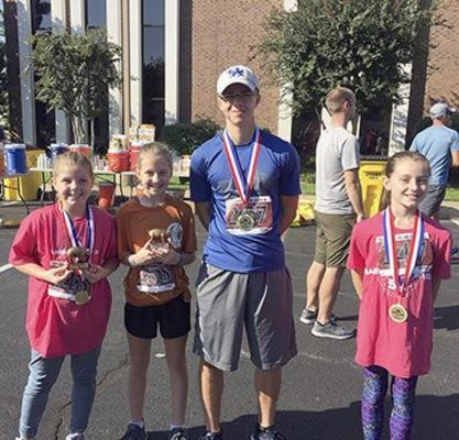 BARBECUE ON THE RIVER – Fulton County was represented in the Barbecue on the River 5K Run on Sept. 28. Pictured are McKayden McClure, Chloe McClure, Isaac Madding and Emma Madding. (Photo submitted)