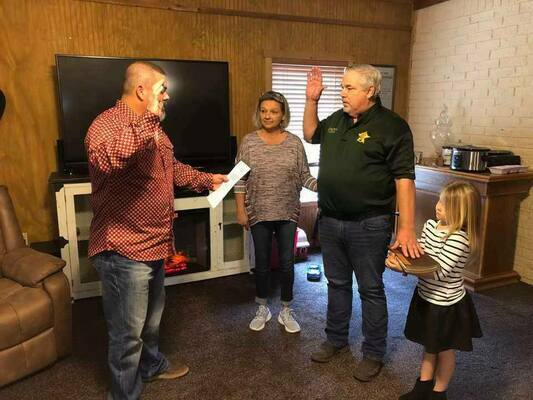 Van Zandt County Precinct 4 Constable Pat Jordan was sworn in by Judge Shinn at his and Melissa Davis' home with granddaughter Livia holding the bible.