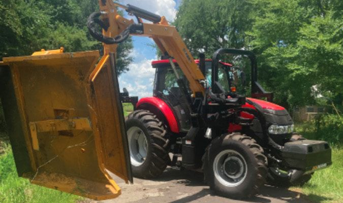 Precinct 1 Commissioner Chad LaPrade recently purchased a boom axe tractor to clear out the right-a-way and trim tree limbs back from the driving surfaces of county roads in his precinct.  Photo by Grand Saline Sun