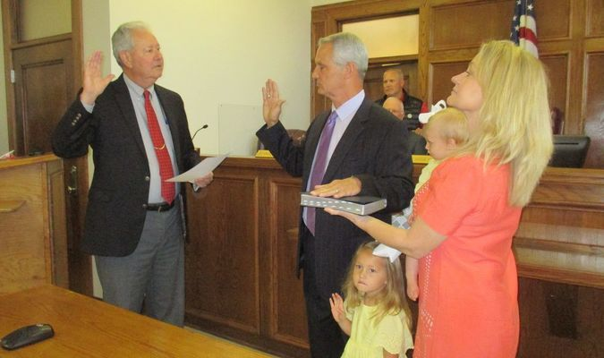 McMillan's friend, Smith County JP Gary Alford issued the Oath of Office while McMillan's wife held the Bible.  Their two granddaughters were part of the occasion.