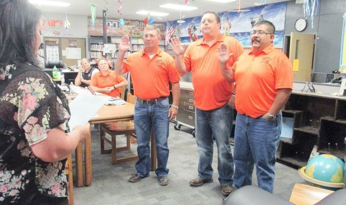 School Board members, Eddie Paul Stanley, Micah Lowe, Paul Moreno take their oath and get back to business resuming the business they have been conducting in their past terms. (Photo by GS Sun)
