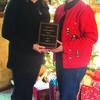 Left, Pamela Allen presents the plaque to Woman of the Year, Paula Briscoe.