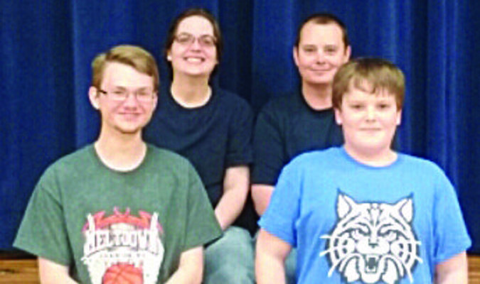 the Thorn family: front (L-R) - Christopher Kemp and Zachary Thorn, back - Christmas Thorn and Danny Thorn.