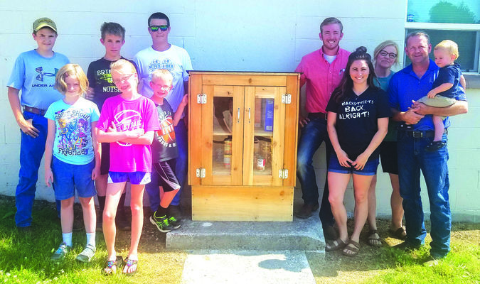 Left of the box are 4-H members Mitchell Gall, Delaney Gall, Brayden Schultz, Emma Sutton, Eli Sutton, and Mason Hayes. To the right of the box, Dadeville First Baptist Church membersBrock Toler,LeahToler,KerriToler, and Michael Toler.  (Submitted Photo)