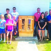 Left of the box are 4-H members Mitchell Gall, Delaney Gall, Brayden Schultz, Emma Sutton, Eli Sutton, and Mason Hayes. To the right of the box, Dadeville First Baptist Church members Brock Toler, Leah Toler, Kerri Toler, and Michael Toler.  (Submitted Photo)