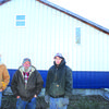 Isaac, Harvey and Sawyer Dodd stand outside their new building.