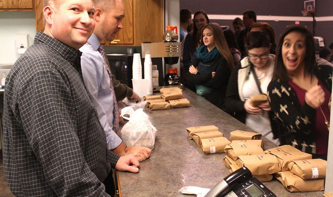 Thomas Frickenschmidt helps pass out sandwiches at lunchtime.