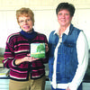 Connie Roseman, left, presents a plaque to Janice Theurer.