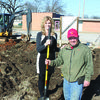 Turning over that first shovel full of dirt are Pamela Allen and Mitchell Boggs.