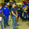 Jessica Youngberg, far right, shows students around and answers questions.