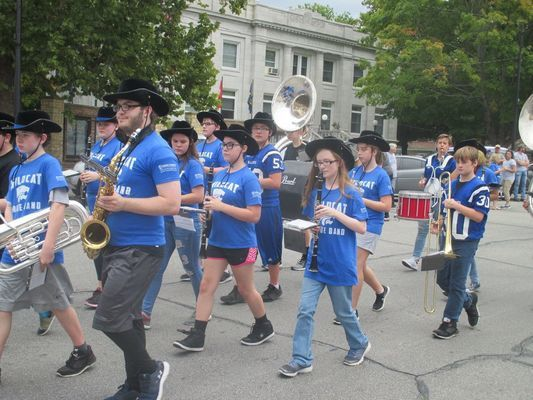 The GHS band marches around the square.