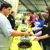 FFA members serve up the chili dinner.