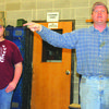 Richard Reid, left, gets 'sold' during the labor auction.