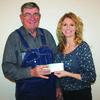 Chuck Daniel, Southwest Cattlemen's Association, presents a check to Pamela Allen for the Summer Feeding Program.