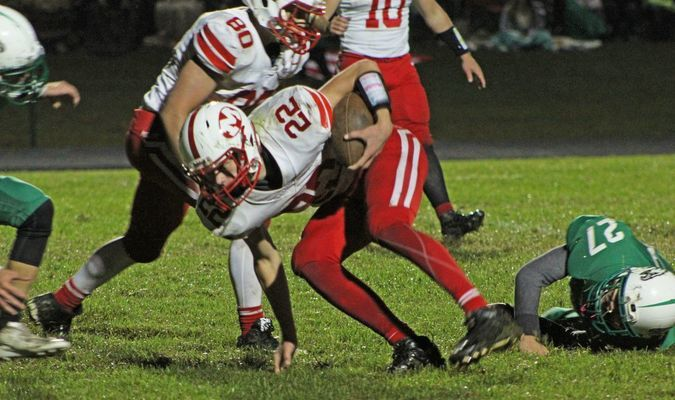 Miller's Nick Johnson, #5, pushes forward while Clay Allen, #74, helps to shake the tackle. (Photo by Gina Langston)
