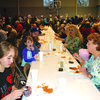 Large crowd enjoys the meal.