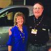 John and Dee Glenn pose by the truck that John's key started.