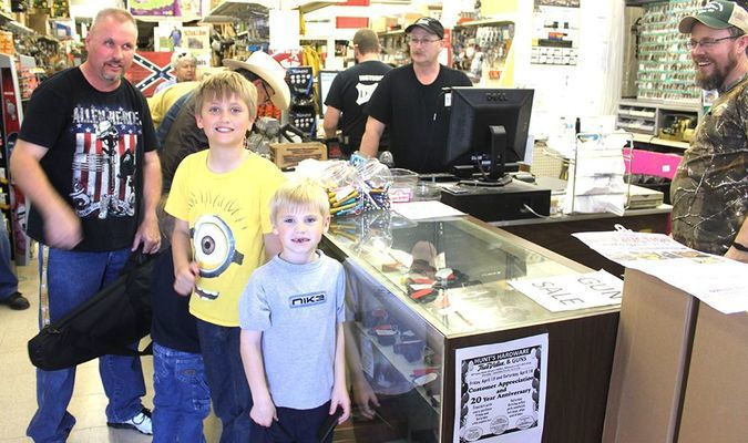Happy, smiling customers enjoy the Customer Appreciation Day at Hunt's True Value and Guns.
