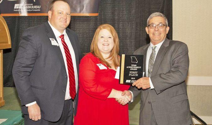 Marc and Megan  Allison accept the award from MOFB President Blake Hurst.