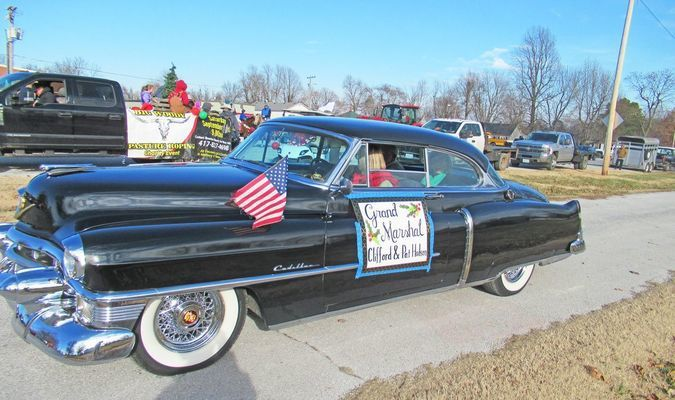 Grand Marshals Clifford and Pat Hodson cruise through the Walnut Grove Christmas Parade, '53 Cadillac-style.