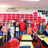 Jackson and LMS Science Teacher Don Borchardt are flanked by other members of the class, who all submitted entries into the same contest won by Jackson. (Photos by James McNary)