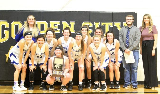 The Greenfield Lady Wildcats won the Goden City Tournament with a 60-26 win over Liberal. (Photos by Werthy Mai)