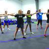 Greenfield Cheerleaders warm up before practice.