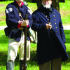 A Union officer (Gary Morris) confers with one of his men on the sidelines.