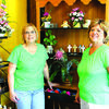 Judi Frost, left, and Sherry Killingsworth, owners, pose with some their arrangements.