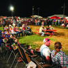 The crowd covers the rodeo grounds as they  listen to the bands. photo by Penny White