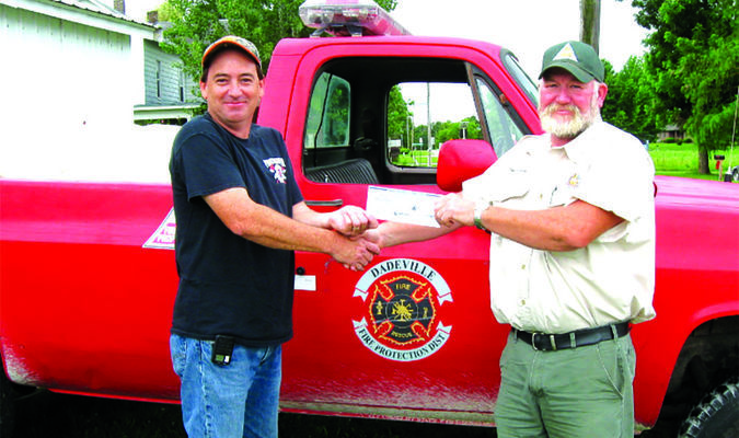 MDC Forestry Assistant Ben Buckner, right, presents the check to Dadeville Fire Chief Brian Sneed.