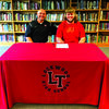 Janssen Coble, right, with Coach Clay Lasater.