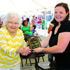 LaRue Lemons accepts a plaque extolling her hard work done for the Lockwood Community.