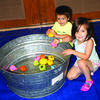 Killian, 2, and Sophia, 4, children of Dan and Hope Janes, win at the duck pond.