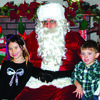 Cynthia and Richie Rulewich visit with Santa after Miller Christmas parade Saturday, December 10. More pictures page 12.