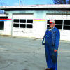 John Richter stands in front of the building  before it comes down.