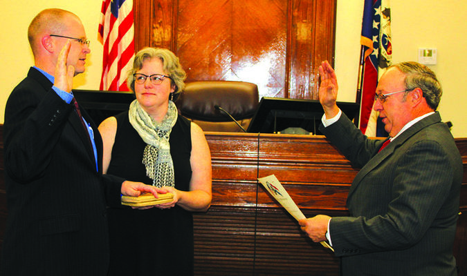 Gary Troxell, left, was sworn in as Associate Circuit Judge for Dade County by Judge David Munton. Pictured with Troxell is his wife, Robin Troxell.