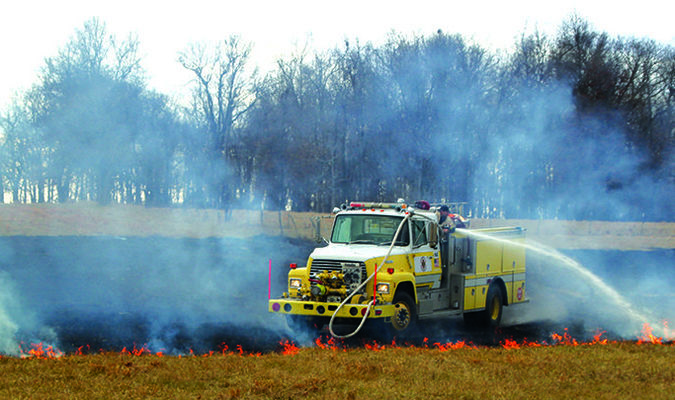 Firefighters get the fire at the Edwards Farm under control.