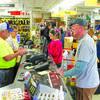 Meek's staff was kept busy helping customers.