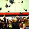 The graduates celebrate with a cap toss.
