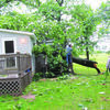 The home of Frank and Becky Jerome had a tree to land across it.