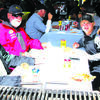 Danny Friend, Leonard DeClue, Kelton Morris and Sean Mulkey enjoy their meal after a day of fishing.