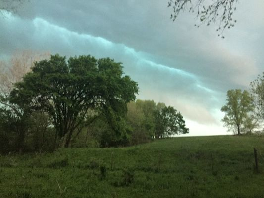 A green-tinted sky and menacing shelf cloud advance with a storm front over rural Lawrence County on May 3, shortly before unleashing a torrent of hail on the area. (Photo by Gina Langston)