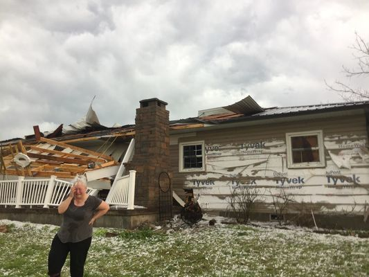 Patty Langston reveals her emotions about the day's events related to the sudden hail storm in Lawrence County.  (Photo by Gina Langston)