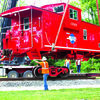 Moving the caboose off the truck onto the tracks