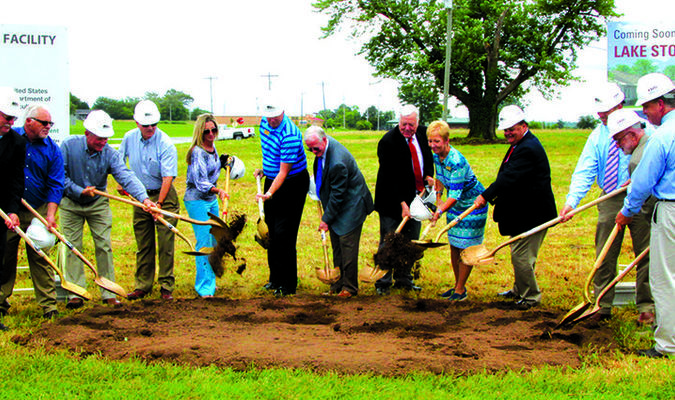 Left to right: Bob Keller, CEO, Larry Snyder & Co.; Chuck Mauck, Director of Plant Facilities, CMH; Russell Payne, Board Member, CMH Foundation; Neale Johnson, DDS, Board Member, CMH Foundation and Stockton Nursing Home;  Melody Roach, Area Specialist, USDA Rural Development; Brad Gregory, Board Vice President; CMH Foundation, Board Member, CMH; Donald J. Babb, CEO, CMH; Executive Director, CMH Foundation; Clark Thomas, Community Program Director, USDA Rural Development; Melinda Gumm, Board President, Stockton Nursing Home; Dave Strader, Board President, CMH Foundation; Chris McBratney, Administrative Director, CMH Long-Term Care West; Larry Nelson, Architect; and Kevin Costello, Administrator, Lake Stockton Healthcare Facility. Photo by Cletis McConnell, Vedette Reporter