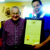 Lawrence Huser, right, receives a 100th Birthday Resolution plaque from State Representative, Mike Kelley. Photo submitted by Lisa Eggerman.