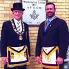 Left, Grand Master MWB Richard Smith with Washington Lodge #87, AF&AM, Lodge Master WB Zach Adams.