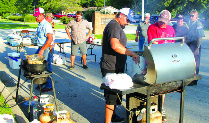 The cooks from the Lockwood Fire Department are hard at work to get everything ready for the crowd.