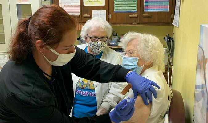 Leila Spicer, 100, receives her second dose of the COVID-19 vaccine from Christine Schultz, RN, while Ardella Lack, RN, observes on Monday, April 12 at the Dade County Health Department. Spicer is the oldest COVID-19 vaccine recipient yet seen by the DCHD. (Photo courtesy Pam Cramer, DCHD)